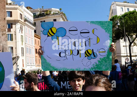 Fridays for future (FFF). Rome third global climate change strike for future. Young students demonstration march protest against climate change. System change not climate change. Students holding up banner sign, took to the streets to demonstrate against global climate change in central Rome, Italy, Europe, European Union. Every Friday skrike. 27th september 2019 - Stock Photo