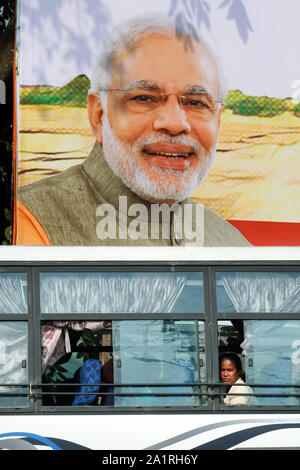 Indian Prime Minister Narendra Modi on a poster in the city of Tezpur, Assam State, India, Asia - Stock Photo