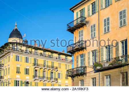 Old colorful buildings with shutters on windows on Place Saint François, Vieille Ville (Old Town), Nice, Alpes-Maritimes, Provence-Alpes-Côte d'Azur, - Stock Photo