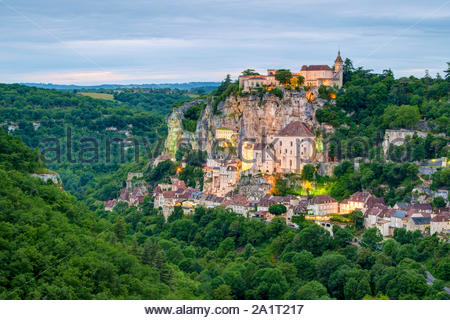 Rocamadour, pilgrimage town along El Camino de Santiago at dusk, Lot Department, Midi-Pyrénées, France - Stock Photo