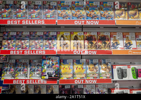 a variety of video games for Nintendo Switch displayed on a shelf in the store. Melbourne, VIC Australia. - Stock Photo