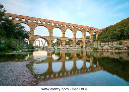 Pont du Gard Roman aqueduct over Gard River at sunset, Gard Department, Languedoc-Roussillon, France - Stock Photo