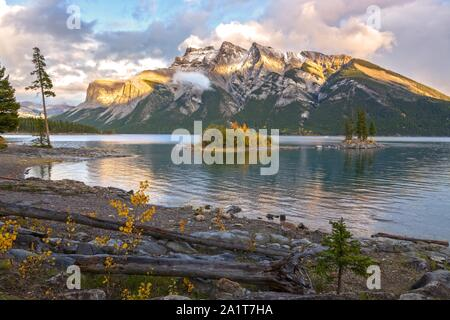Autumn Landscape Scenery of Beautiful Lake Minnewanka during Fall Colors Change in Banff National Park, Canadian Rocky Mountains - Stock Photo
