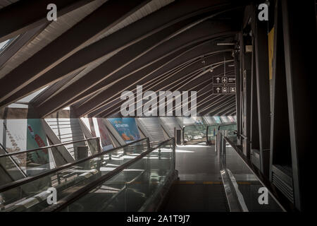 LYON, FRANCE - JULY 13, 2019: Travelator and Moving Walkway in Lyon Airport, also called Aeroport de Lyon Saint Exupery, empty, connecting two termina - Stock Photo