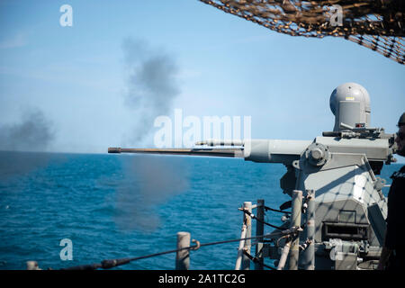 190926-N-PI330-0238 ATLANTIC OCEAN (Sept. 26, 2019) A MK 38 25mm gun mount is fired aboard the Ticonderoga-class guided-missile cruiser USS San Jacinto (CG 56) during a live-fire exercise. San Jacinto is underway conducting normal operations. (U.S. Navy Photo by Mass Communication Specialist 3rd Class Andrew Waters/Released) - Stock Photo