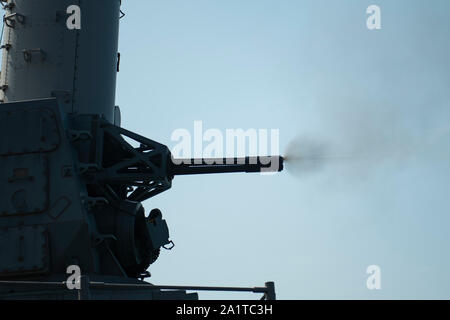 190926-N-PI330-0316 ATLANTIC OCEAN (Sept. 26, 2019) The close-in weapons system aboard the Ticonderoga-class guided-missile cruiser USS San Jacinto (CG 56) is fired during a live-fire exercise. San Jacinto is underway conducting normal operations. (U.S. Navy Photo by Mass Communication Specialist 3rd Class Andrew Waters/Released) - Stock Photo