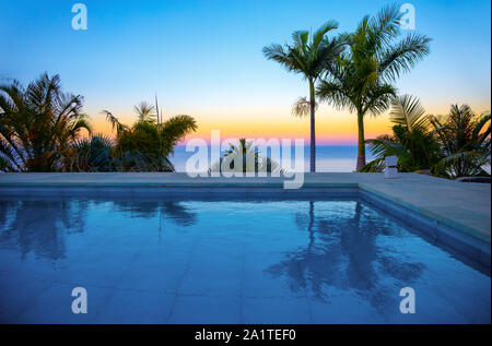 Swimming pool at sunset, La Palma, Canary Islands, Spain, Europe. - Stock Photo