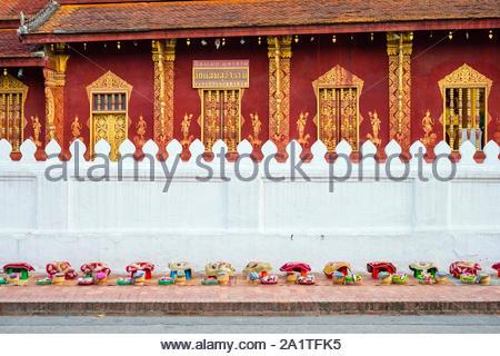 Almsgiving (Tak Bat) in front of Wat Sene Souk Haram temple, Luang Prabang, Louangphabang Province, Laos - Stock Photo