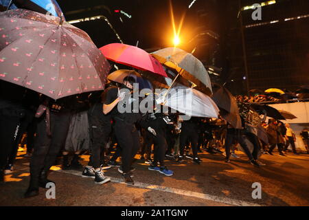Hong Kong, China. 28th Sep, 2019. Protesters holding umbrellas during the rally.Demonstrators gathered for an anti-authoritarian rally that marked the 5th anniversary of the beginning of the 2014 'Umbrella Movement'. Thousands of protesters gathered peacefully, but minor clashes between protesters and police escalated through the night, leading to a police dispersal operation. Protesters continue to clash with police as they reiterate their 5 demands. Credit: SOPA Images Limited/Alamy Live News - Stock Photo