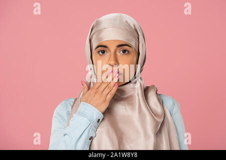 shocked pretty muslim girl in hijab, isolated on pink - Stock Photo