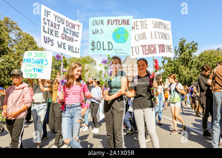 TORONTO, ONTARIO, CANADA - SEPTEMBER 27, 2019:  'Fridays for Future' climate change protest. Thousands of people march with signs.