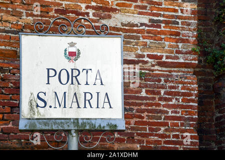 Close-up of the name sign of Porta Santa Maria (St Mary Gate), one of the six ancient city gates, built between 1592 and 1594, Tuscany, Italy - Stock Photo
