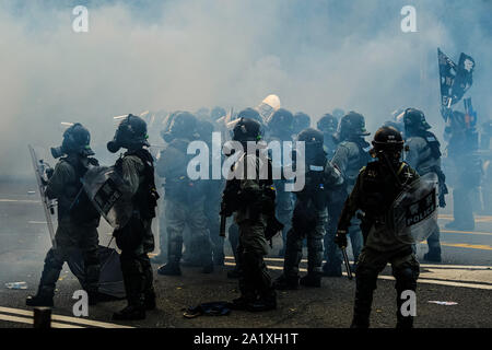 Hong Kong, China. 29th Sep, 2019. Riot police are seen near Central Government Complex in Hong Kong during the Anti-Totalitarianism March. Almost four months long protests between Hong Kongers and riot police continues and conflict escalated ahead of the 70th anniversary of communist China's founding. Credit: Keith Tsuji/ZUMA Wire/Alamy Live News - Stock Photo