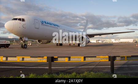 Glasgow, UK. 28 September 2019.  Pictured: Eastern Boeing 767-300 the tarmac after just landing. Following the immediate fallout from the collapsed tour company Thomas Cook, Operation Matterhorn is still in full swing at Glasgow Airport. The grounded and impounded Thomas Cook aircraft have been moved to a quieter part of the airfield to make way for the wide body fleet needed for operation Matterhorn. Colin Fisher/CDFIMAGES.COM - Stock Photo