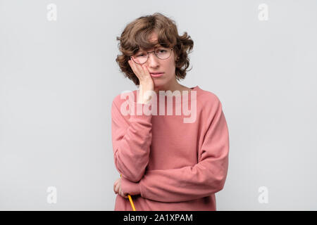 I am tired of everything. Bored young caucasian woman. Studio shot - Stock Photo