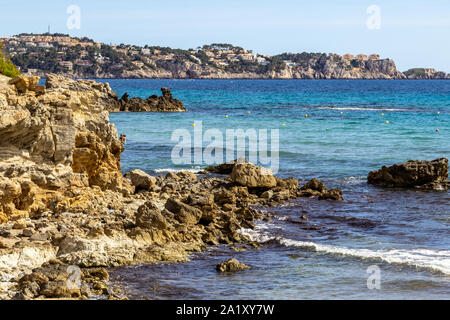 Rocky coast at Peguera in the west of Mallorca on a sunny day in spring - Stock Photo