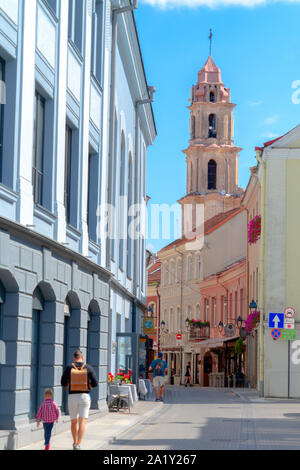 Vilnius, Lithuania - August 19, 2019: People walking in beautiful Savicius street of Vilnius old town, Lithuania - Stock Photo