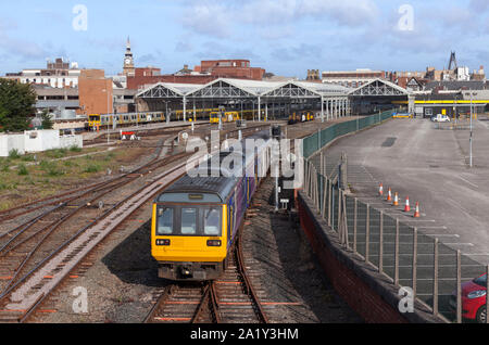 Arriva Northern rail class 142 pacer train + class 150 sprinter departing from Southport railway station with Merseyrail trains in the station - Stock Photo