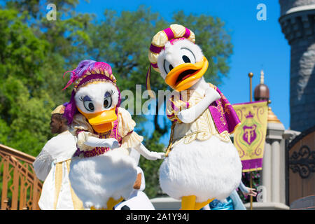 Daisy Duck and Donald Duck at Cinderella Castle, Magic Kingdom, Disney World, Orlando, Florida - Stock Photo