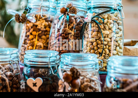 Different types of nuts and seeds in glass jar close up. A variety of nuts in glass jars. - Stock Photo