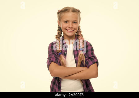 Child little girl colorful braids fashionable hairstyle isolated white. Teenage fashion concept. Fashionable hairstyle. Casual style fashion. Girl confidently crossed arms on chest. Fashion trend. - Stock Photo
