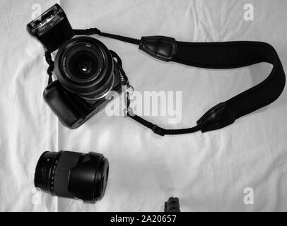 Photographer camera, camera lens and gadgets over white background - Stock Photo
