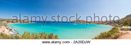 Beautiful colorful beach at Crete island, Greece. Voulisma paradise beach with rocks and mountains.  Summer vacation travel holiday background concept - Stock Photo
