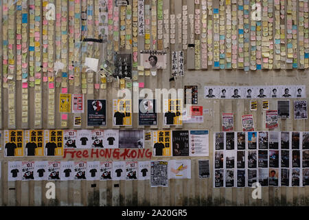 Posters and messages covering the walls and pavements in Kowloon, Hong Kong, where authorities have rejected an appeal for a major pro-democracy march on China's National Day holiday, following two straight days of violent clashes between protesters and police. - Stock Photo