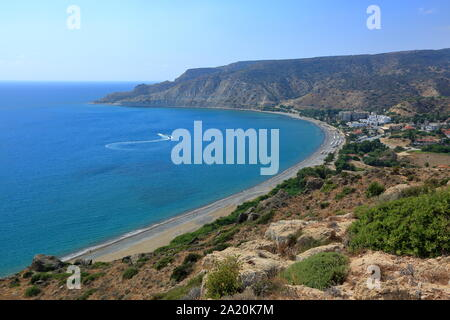 Beautiful landscape of Mediterranean sea bay and beach in Pissouri village, Cyprus, sand, arid hills surrounding area, seen from top of  point view. - Stock Photo