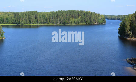 Scenic view to lake Saimaa from Toijansalmi bridge, Taipalsaari, Finland. Beautiful summer day, water surface is almost calm, just a little ripples. - Stock Photo