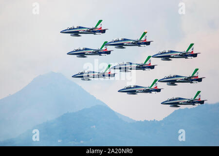 Varenna, Italy - SEPTEMBER 29, 2019:The aerobatic 'tricolor arrows' team of the Italian military aeronautics performs above Lake Lecco during an airsh - Stock Photo
