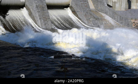 Hydroelectric power station dam sluice gate open. Panorama view. - Stock Photo