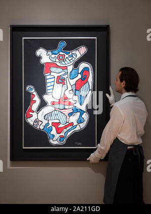 A gallery assistant observes Jean Dubffet's Cafetiere V, 1965, during a press preview at Bonhams New Bond Street, London, ahead of its sale by auction at Bonhams' Post-War and Contemporary Sale on October 3. The art piece is expected to fetch between ??500,000-??700,000. - Stock Photo