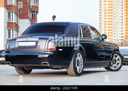 Novosibirsk, Russia - 07.25.2019: Rear side view of new a very expensive luxury Rolls Royce Phantom car, a long black limousine, model outdoors, prepa - Stock Photo