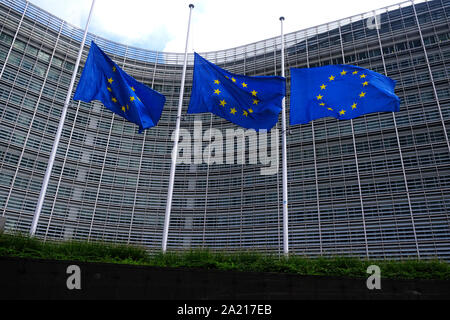 Brussels, Belgium. 30th Oct. 2019.  The European Union flags fly at half-mast as a tribute to former French President Jacques Chirac in front of the European Commission building.