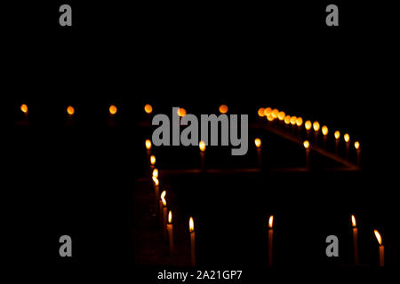 Burning candles decorations at balcony or roof top of a house during Diwali celebration at night with copy space. Background concept for home decorati - Stock Photo
