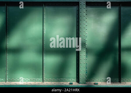 Abstract green metal textured background with rivets and bolts
