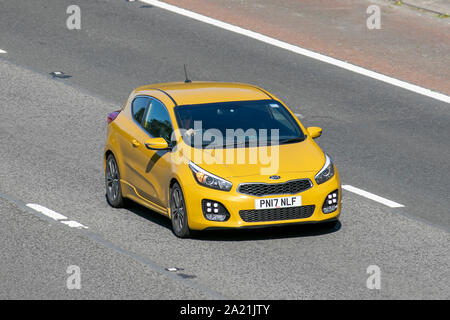 2017 yellow Kia PRO Ceed Gt-Line ISG drivingn on the M6 in Lancaster, UK - Stock Photo