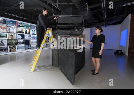 London, UK.  30 September 2019. Staff members make final adjustments to 'Watchhouse', 2019, by Soyoung Chung.  Preview of 'Negotiating Borders', an exhibition organised by the Real DMZ Project exploring the history and future of the DMZ (Demilitarised Zone), the four kilometre wide invisible military borderline at which North and South Korea face each other.  Works by seven Korean artists is on display at the Korean Cultural Centre UK, 1 October to 23 November 2019.  Credit: Stephen Chung / Alamy Live News - Stock Photo