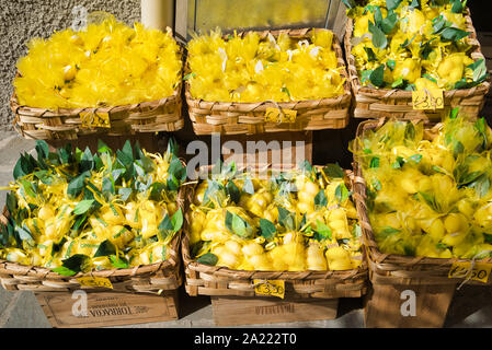 Riomaggiore, Cinque Terre, Italy - August 17, 2019: Boxes of packed lemons in a shop on a city street - Stock Photo