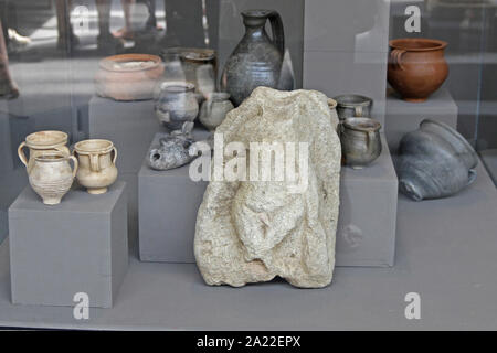 Ancient rock artifact, ceramic clay jars, jugs and pots on display in glass case at the National Archaeological Museum Djerdap, Kladovo, Serbia. - Stock Photo