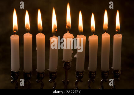 Nince candles in a jewish hanukkah candle-holder - Stock Photo