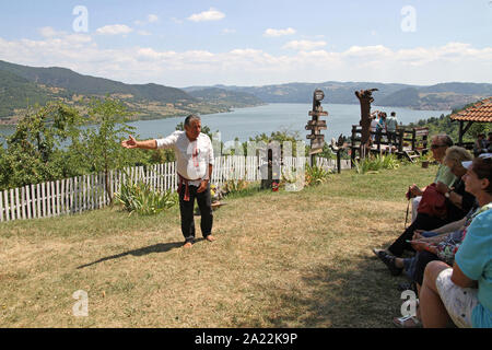 Host and tour guide with tourists on Captain Misha Hill Eco-Gallery, Karapacos, Lower Milanovac, Serbia. - Stock Photo