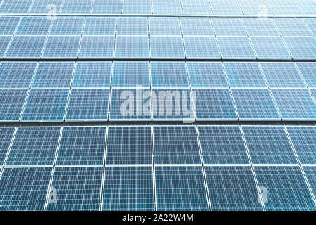 Aerial top view of a solar panels power plant. Renewable energy concept . Detailed close-up of modern large photovoltaic solar panels