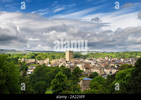 Historic market town of Richmond in North Yorkshire England with Norman Richmond Castle in sun with cloudy sky - Stock Photo