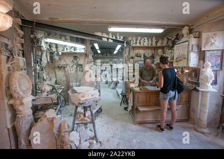 Craftsman Roberto Chiti, specialized in alabaster, in his own laboratory - Stock Photo