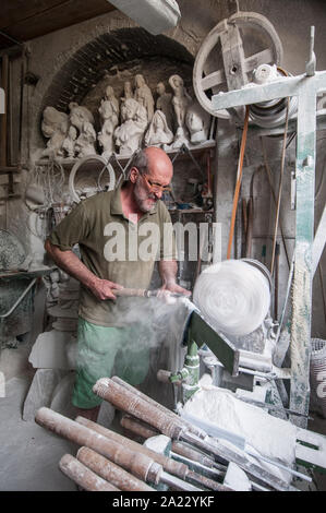 Craftsman Roberto Chiti, specialized in alabaster, working in his own laboratory - Stock Photo