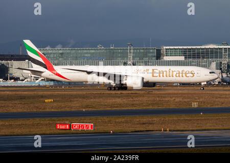 FRANKFURT / GERMANY - DECEMBER 4, 2012: Emirates airlines Boeing 777-300ER A6-EBJ passenger plane taxiing at Frankfurt Airport - Stock Photo