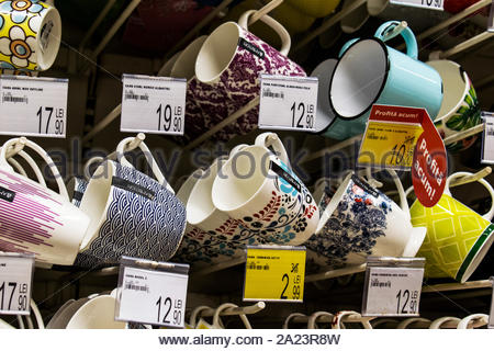 Targu Jiu, Romania. August, 30, 2019- cups and glasses of different sizes, shapes and colors displayed in the store for sale. Their prices are also di - Stock Photo
