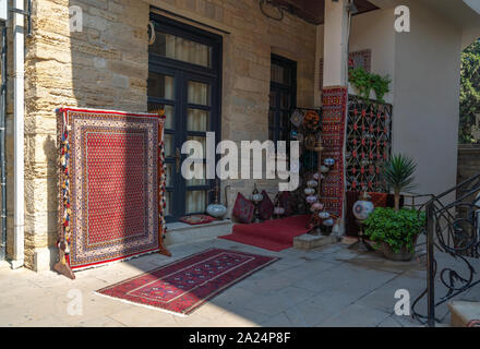 Sale of old carpet and souvenirs in eastern city - Stock Photo